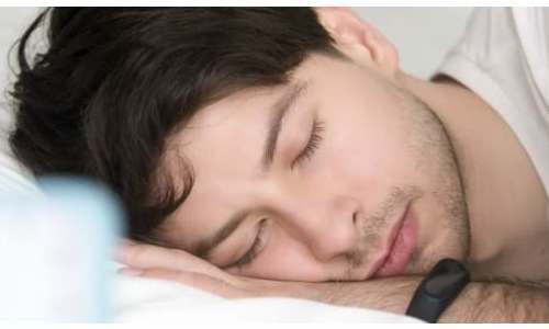 Wearing a smart watch while sleeping.