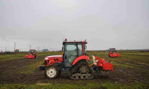 Robot tractors on a farm in Hokkaido, Japan.