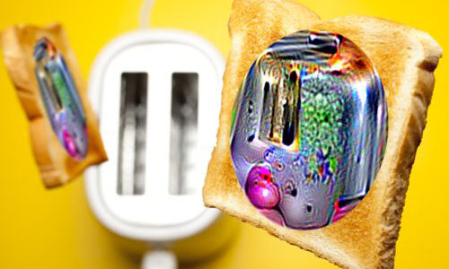 Piece of toast with colored sticker and toaster in background