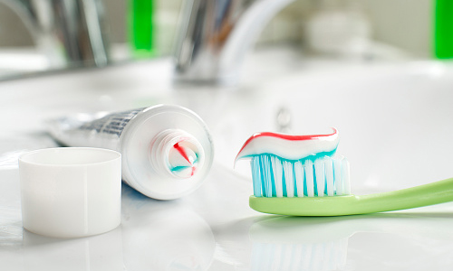 Toothpaste and toothbrush on counter