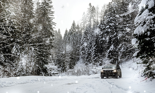 Black car on a snowy road