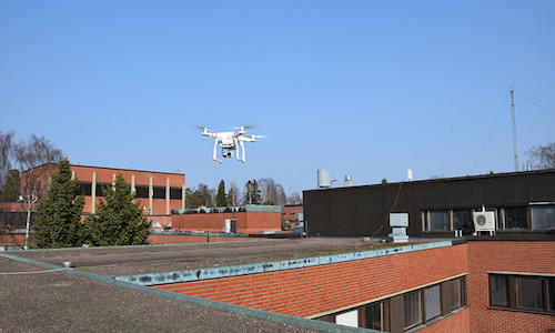 A drone hovering above a building.