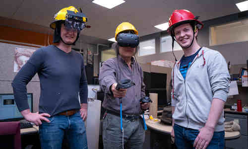 Firefighters demonstrate Haptic Helmet prototypes.