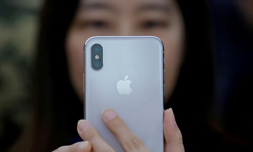 A woman holding an iPhone