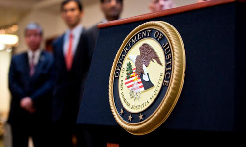 A US Department of Justice seal is displayed on a podium