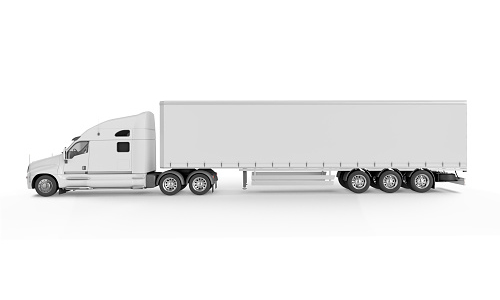 Side view of a white semi-trailer truck