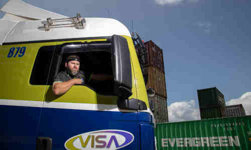 A truck driver wears a headband that monitors his biometric data for fatigue.