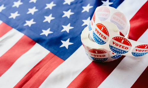 American flag and roll of 'I Voted Today' stickers