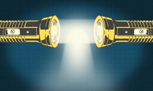 Two flashlights creating one single beam of light