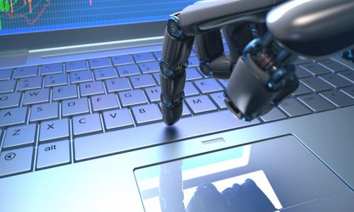 robot hand at keyboard