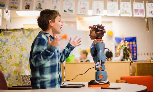 Milo the robot and student with autism