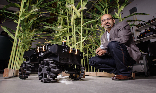 Agricultural and biological engineering professor Girish Chowdhary with TerraSentia, a crop phenotyping robot.