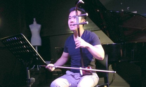 Researchers Luwei Yang plays the erhu