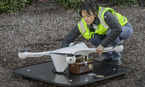 Operator prepares drone to carry medical specimens