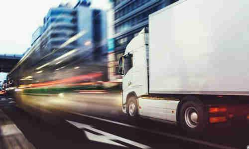 A truck speeding through an intersection.