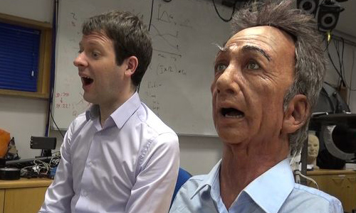 Charles the robot (right) mimicking the expression of a researcher (left)
