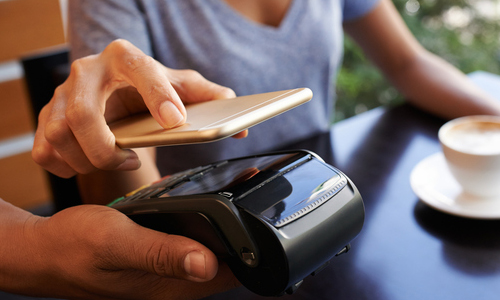 Phone being scanned by credit card scanner