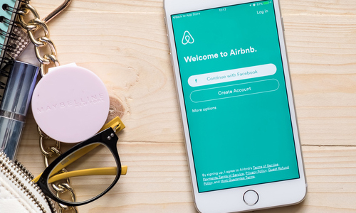 A phone with the Airbnb app in use