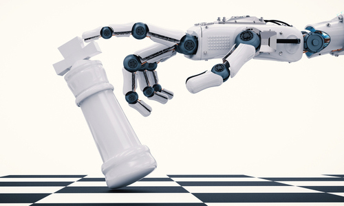 Robotic hand holding a chess piece