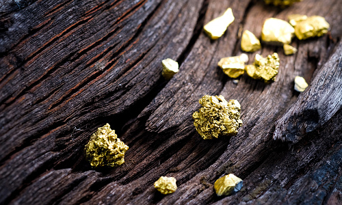 Pure iron ore on a wooden plank