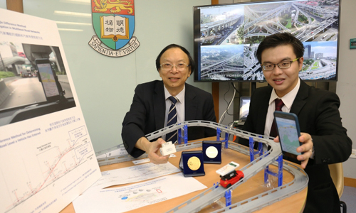 Professor Anthony Yeh Gar-On and a member of his research team with model of their GPS system (HKU)