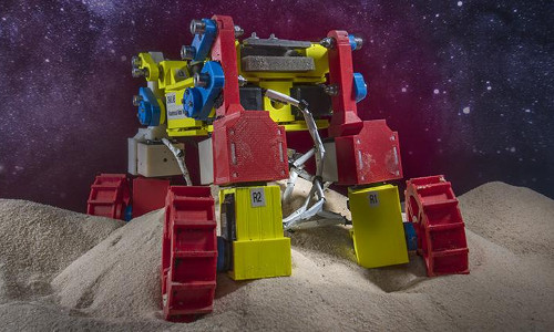 Planetary Exploration Rover Avoids Sand Traps with 'Rear Rotator Pedaling'