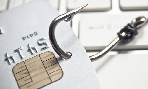 A fishing hook hooked onto a credit card