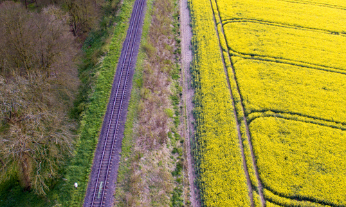 Aerial photo of a train track and a field