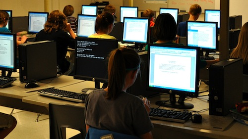 A classroom of students working on computers
