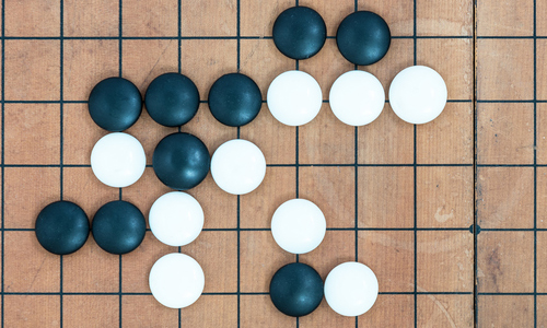 a Go board with pieces