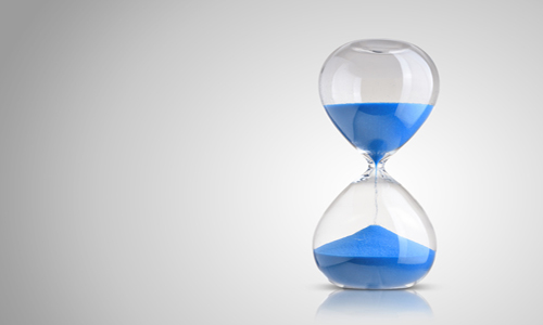 An hourglass with blue sand