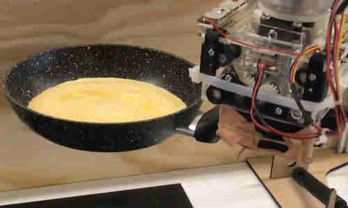 The robot chef in mid-omelet.