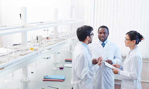 Scientists having discussion in a lab
