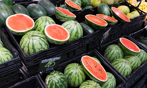 Crates of watermelons in the fruit and vegetable department of a supermarket
