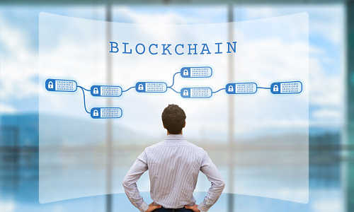 Person looking at blockchain concept on screen
