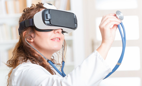 Doctor wearing VR headset