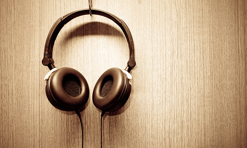Headphone hanging on wooden wall