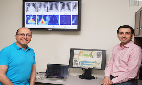 Professor Shahrokh Valaee and PhD candidate Hojjat Salehinejad in front of the simulated chest X-ray images used to train AI systems to identify rare pathologies.