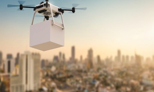 A drone gripping a package.