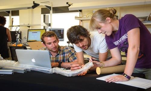 Joseph Greer, Laura Blumenschein, and Elliot Hawkes working on vinebot prototype