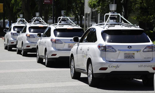 A line of Google's self-driving vehicles