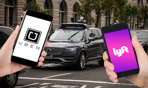 Two cellphones, one showing Uber app and one showing Lyft app.