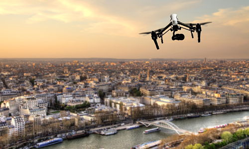 Drone camera flying over Paris