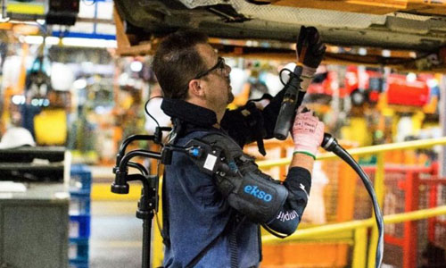 Ford factory employee wearing exoskeleton
