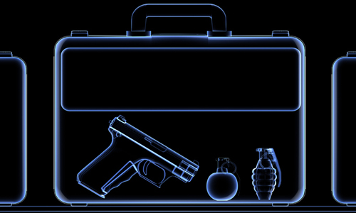 X-ray of briefcase containing a handgun, a bomb, and a grenade