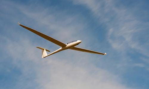 Glider plane in blue sky