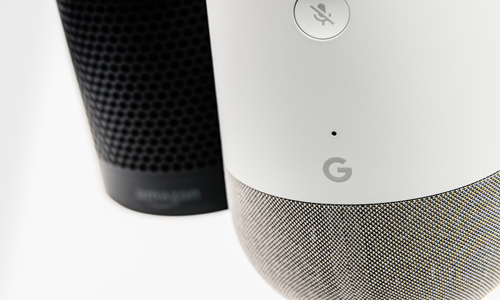 Close up of Google Home and Amazon Alexa device