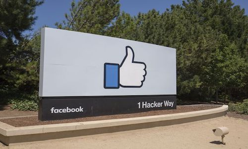 The Facebook sign outside its corporate headquarters