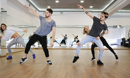 Professional dancers rehearsing in a studio