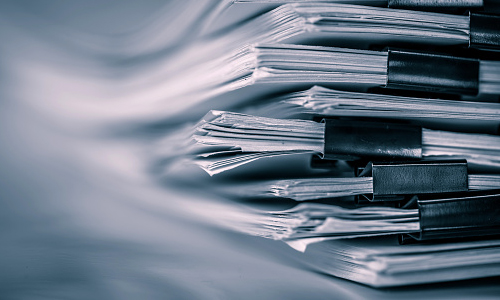 Stack of documents bound with with binder clips